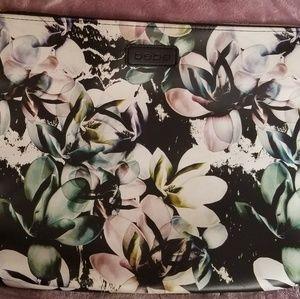 Bebe large floral clutch.